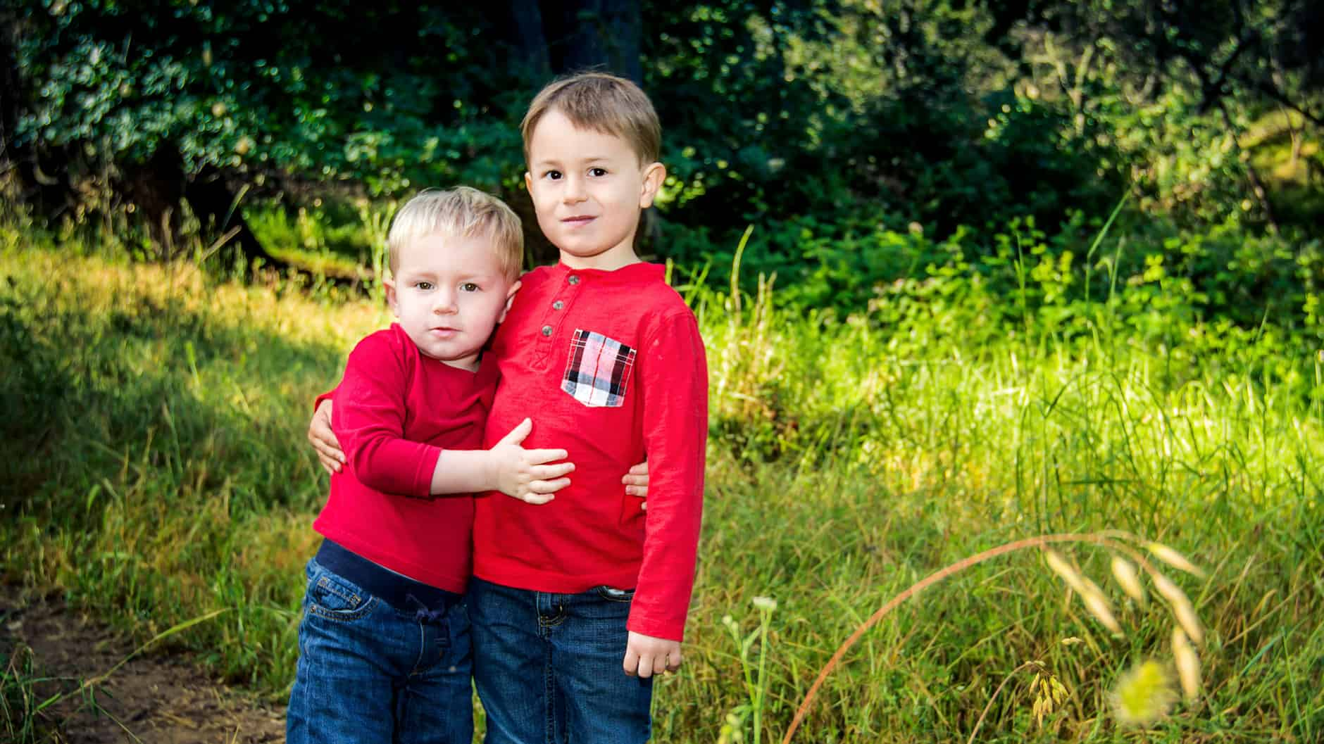Brothers posing in a field